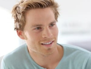 Photo of a blonde man smiling, for pain free dentistry in Lowell, MA from Dr. Michael Szarek.